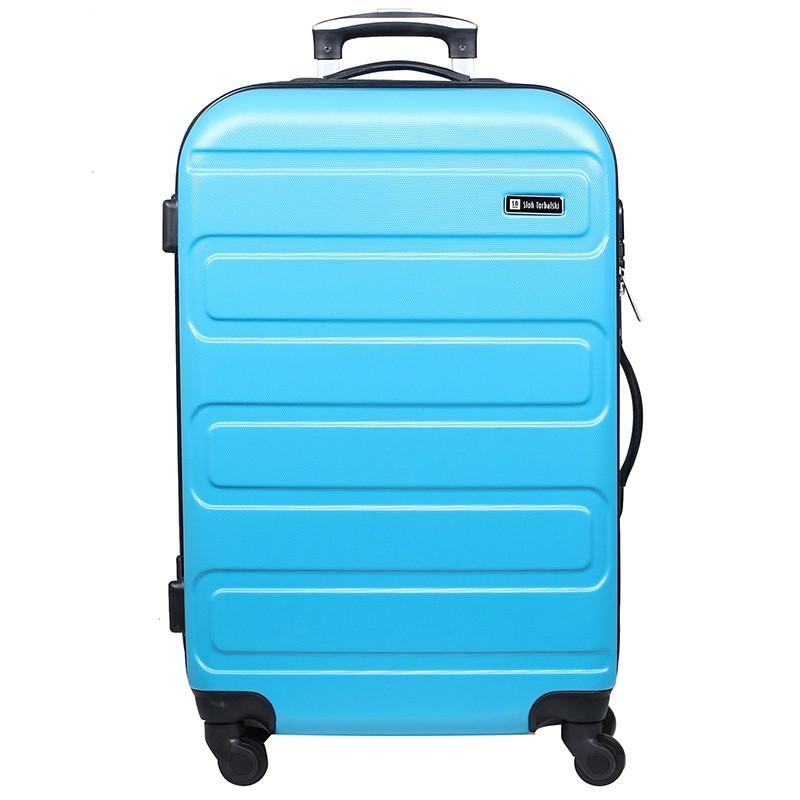 duża niebieska walizka na czterech kółkach